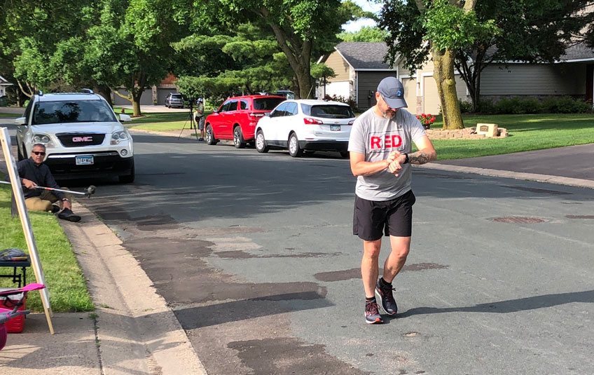 A man running on a suburban street