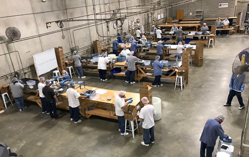 Incarcerated men pack Feed My Staving Children meals at the Faribault Correctional Facility in Faribault, Minnesota
