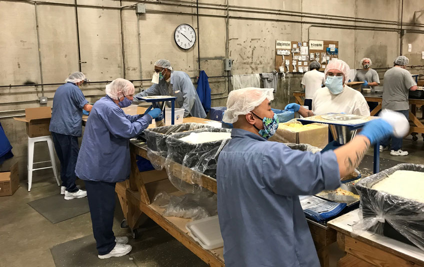Incarcerated individuals packing FMSC meals at a correctional facility