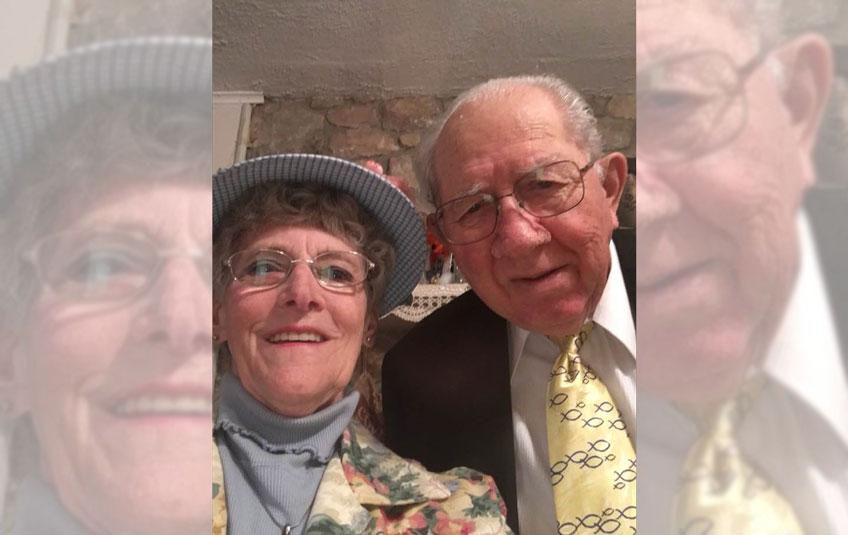 A selfie of elderly couple in formal attore