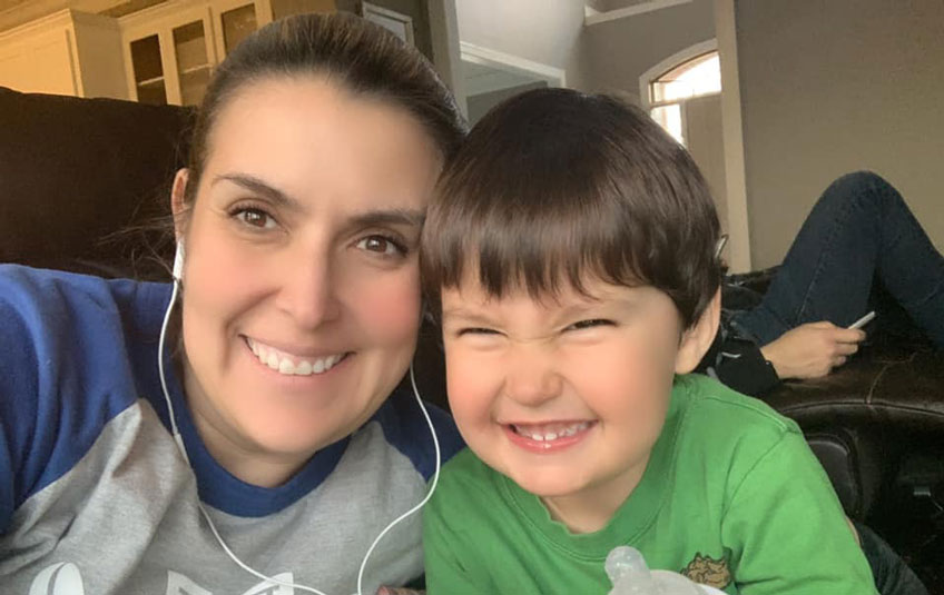 A mother and son smiling