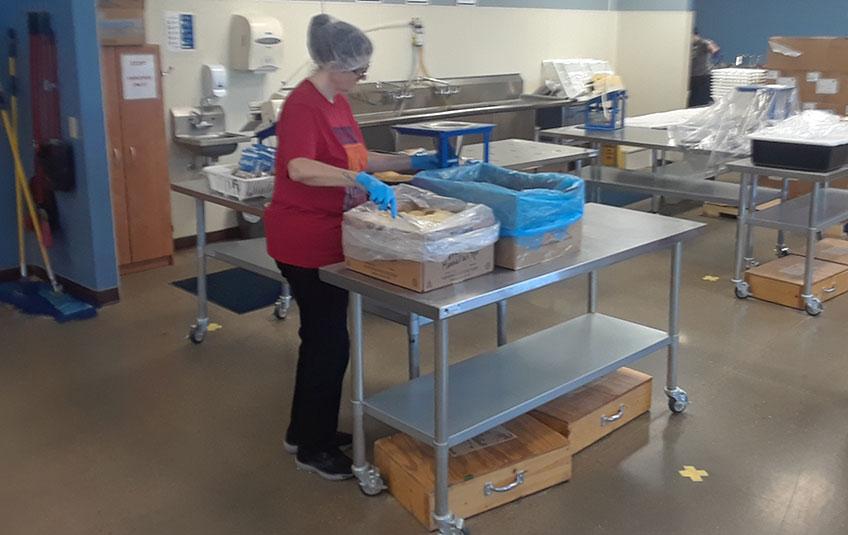 jennifer moulton standing by FMSC ingredient boxes