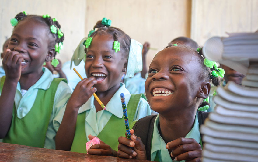 three schoolgirls smiling