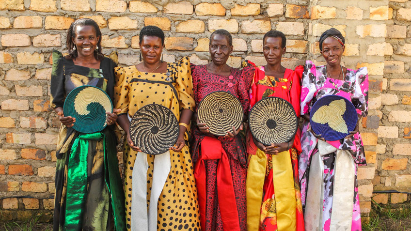 Ugandan women hold the ethically produced artisan goods they've made for FMSC's MarketPlace