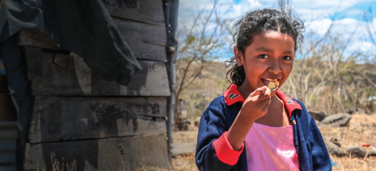 A girl in Nicaragua eats FMSC food