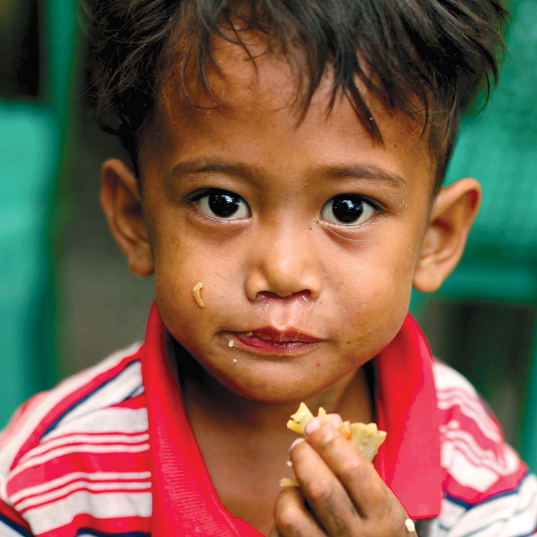 Child eating MannaPack Rice