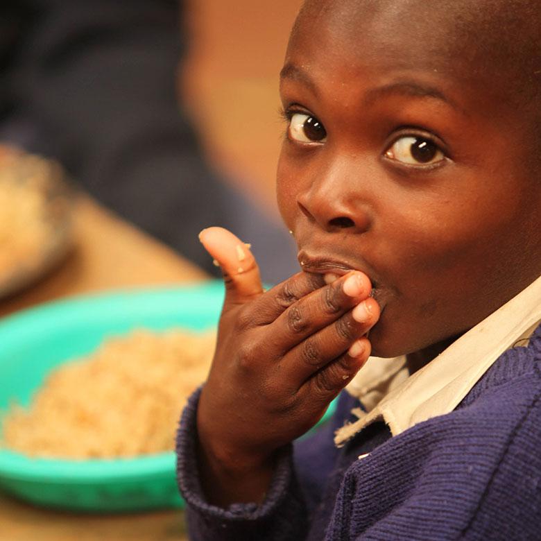 Child eating MannaPack Rice